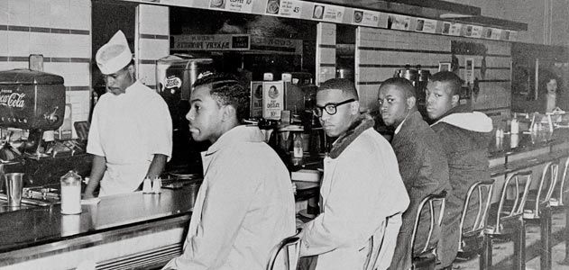 historic image of men participating in the greensboro sit in