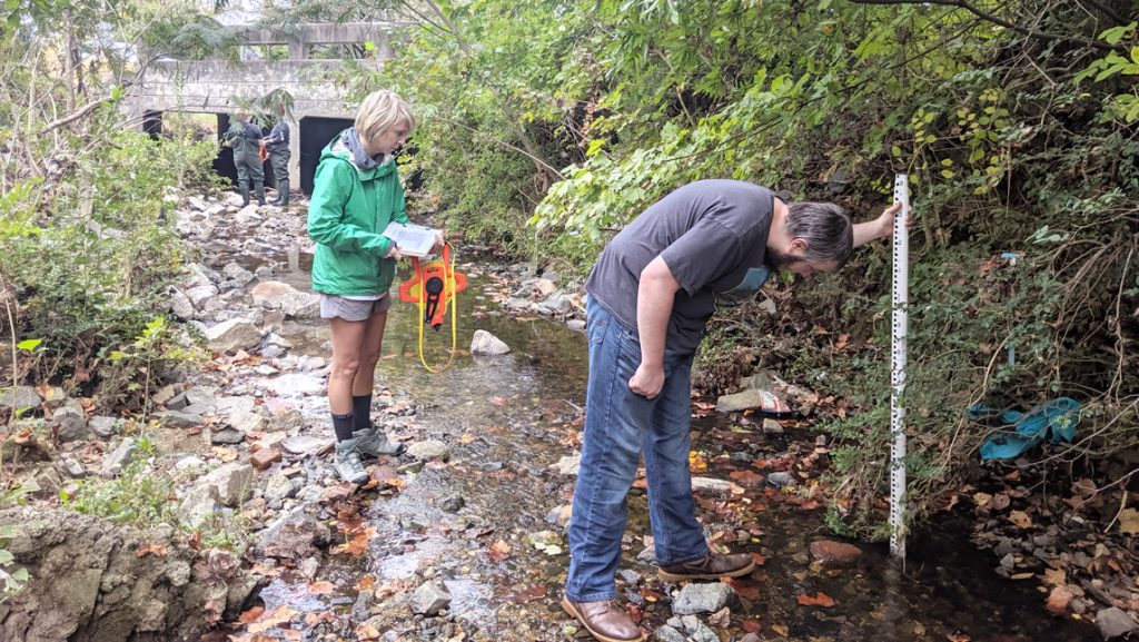 Two students in a river working
