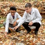 Image of Dr. Oberlies and student in leaves
