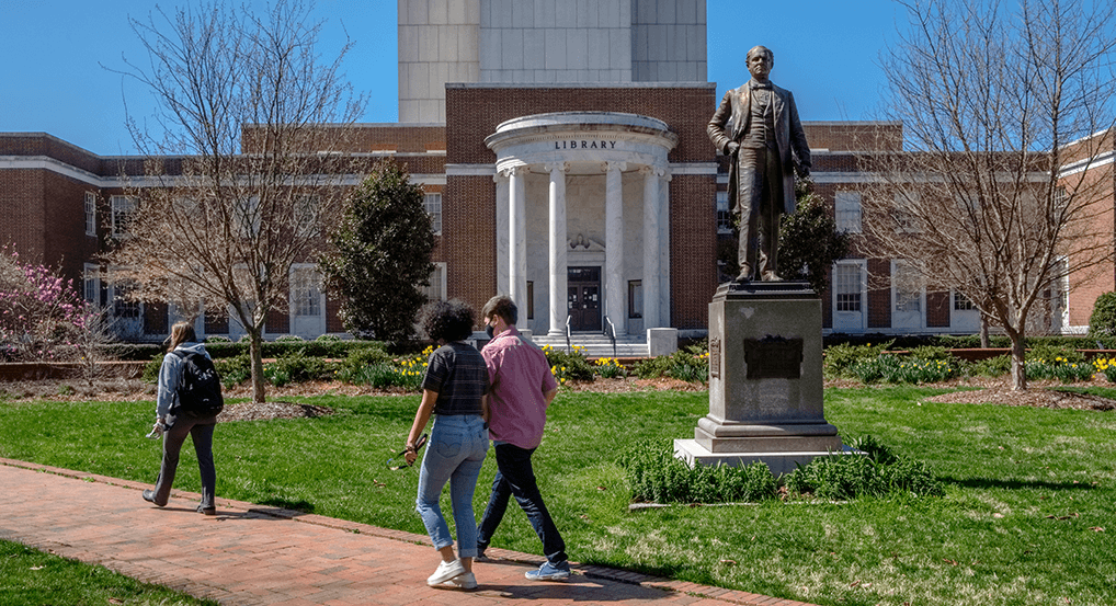 students walk on campus