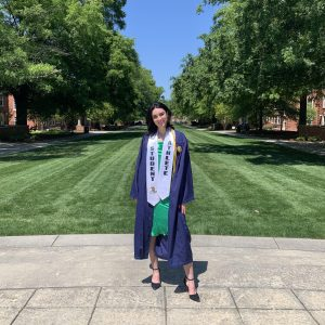 Graduate stands in commencement robes