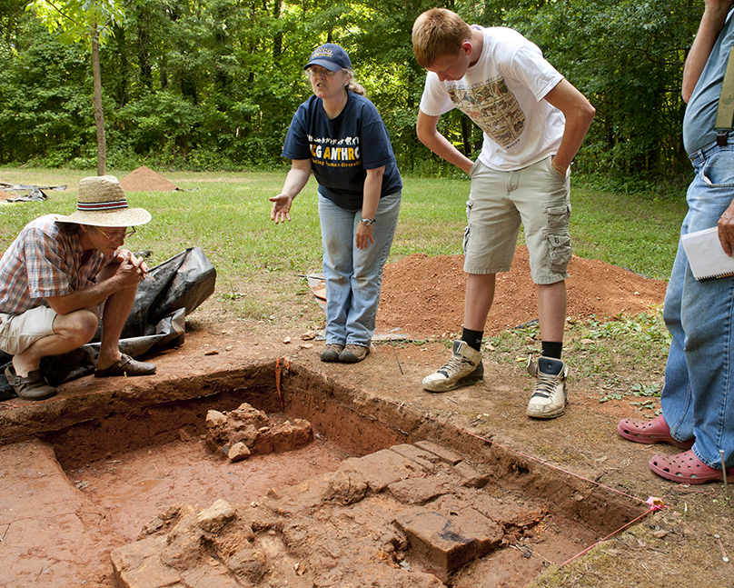 professors and students at archaeological dig site